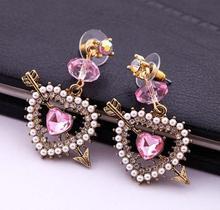 Fashion fashion accessories cupid arrow heart earrings