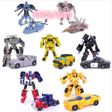 Free shipping Christmas Gift Robot Optimus Bumblebee Sideswipe Starscream Cars Toys 7 pieces/lot(China (Mainland))
