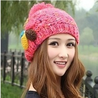 New cute flowers and handmade knitted wool cap hat female Shibei Lei colored balls warm ear Korean big balls