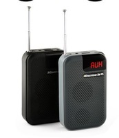 Small portable radio sound card old man outside the small speaker MP3 player