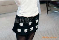 Korean version of the lovely ladies temperament woolen elastic waistband wild flash bow embroidered skirt Q6009