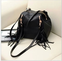 2013 autumn and winter women's handbag tassel PU women's handbag bucket bag preppy style female backpack