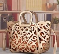 Bolsas femininas Fashion hollow bag cutout leather handbag for women designer tassel bag promotion  Beach bags