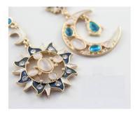 The God of the sun and  moon romantic A cat's-eye Opal Earrings