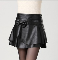 Korean version of the influx of new winter fashion PU leather skirt bow A skirt package hip boots pants Women Short skirts woman
