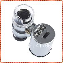 1pcs Bolso Mini 60X Microscópio Lupa 3 LED com uma bolsa de couro falso Nova Frete Grátis(China (Mainland))