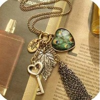 Min. order is $9 (can mix style) fashion vintage female long design peacock feather tassel necklace love key necklace XL245