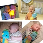 Free Shipping Cute Night Light Acoustooptical Baby Reassure The Small Musical Toys Sea Horse Plush Baby Toys 2 Colors(China (Mainland))