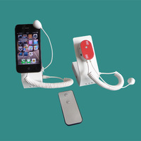 Multiple Mobile Phone Holder With Alarm System