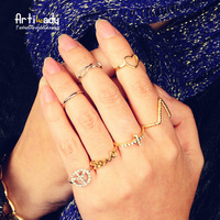 Artilady fashion gold plated 7pcs stacking midi rings crystal heart infinite midi ring women jewelry