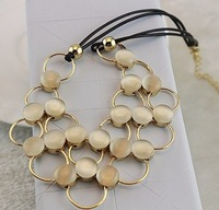 Min Order $15(Can Mix Item)Fashion black chain opal inset rings and circles pendant necklace