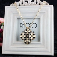 [77 Queen]free shipping wholesale CJ028 Four petals hollow-out flower sweater chain gemstone diamond necklace pendants jewelry