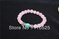 8MM rose quartz  beads bracelet with one turquoise bead in the middle