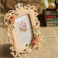 European resin frames carved pale roses