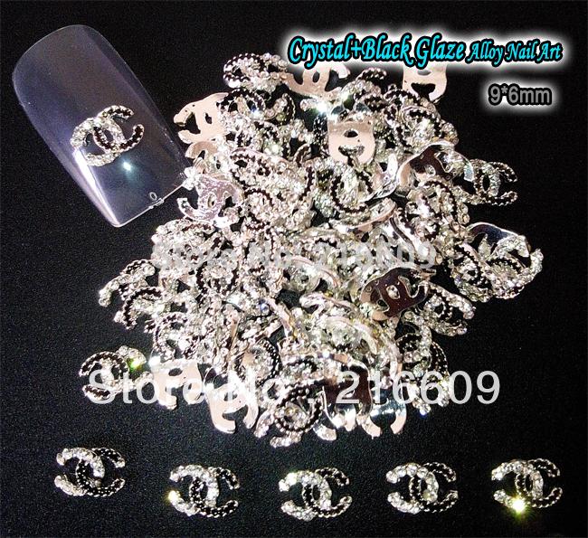 Nail art 20pcs/lot 3d logo en métal design nail art décoration en cristal noir en alliage de strass accessoires nail art livraison gratuite