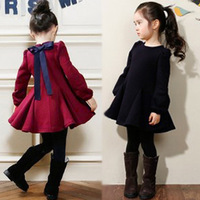 2014 autumn and winter clothing female child bow thickening plus velvet long-sleeve dress.