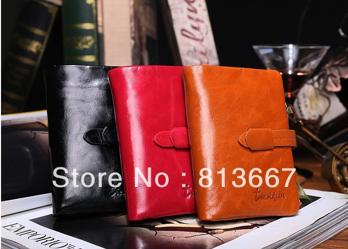 Wholesale free shipping zipper factory head oil wax leather wallet men and women(China (Mainland))