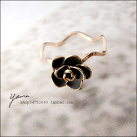 3 - 18k rose gold . elegant camellia water wave ring