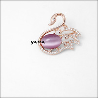 5 - 18k rose gold . - eye inlaying style brooch