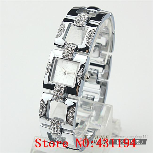 Ladies atacado relógios de ouro marca relógios estudantes mulheres relógio de forma de malha de metal pulseira round dial moda grátis frete(China (Mainland))