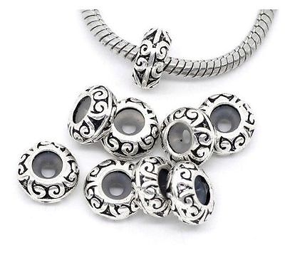 New tibetan silver tone Pattern Stoppers Rubber Beads Fit Charm Bracelet 20pcs(China (Mainland))