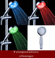 Free shipping and wholesale 3 colors changing hand led  shower head Guaranteed 100%