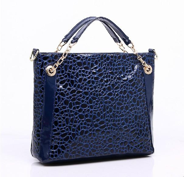 http://i00.i.aliimg.com/wsphoto/v0/1703995078_1/Free-shipping-2014-Women-s-font-b-Leather-b-font-handbag-Fashion-embossed-font-b-stone.jpg