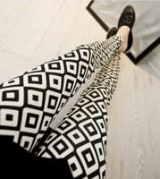 spring of 2014 milk silk flower leggings Black and white diamond lattice geometry stretch feet pants Nine minutes of pants