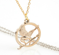 2015 new  The Hunger Games ridiculed the bird fashion round pendant necklace jewelry N05 5pcs