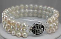 White pearl silver'' FU'' clasp bracelet