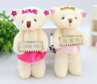 Teddy bear bag flower doll, cartoon bouquet of flowers, flower bag material, florist supplies. The low price wholesale