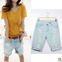 2014 Summer new Korean fashion leisure wild hole wear white pants blue jeans Capris