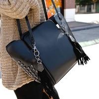 Women bag 2014 Korean version of the new trend of skull rivets tassel bucket bag retro shoulder bag Messenger Bag