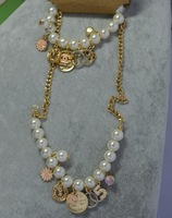 New arrival 2013 small daisy multi element pendant pearl bracelet necklace set