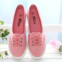 Free shipping 2014 new Summer low canvas shoes female shoes lazy pedal foot wrapping shallow mouth flat-bottomed women sneakers