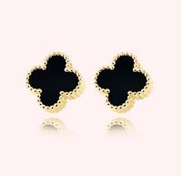 Free shipping  Korean Style Fashion Rhinestone Four Leaf Clover Stud Earrings