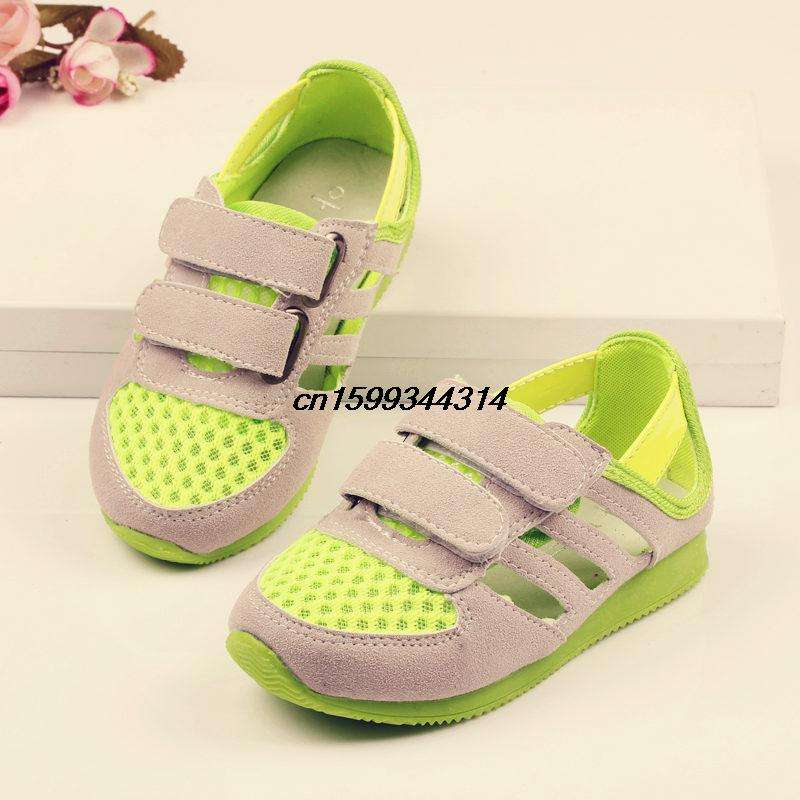 Free shipping 2014 summer new boys sports shoes leather casual shoes children girls candy -colored sport sandals(China (Mainland))