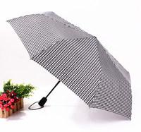2014 free shipping fashion black-and-white grid automatic umbrella business three folding umbrella Rechar017