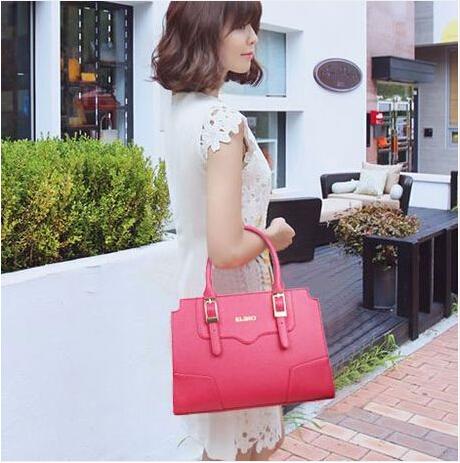 Free shipping 2014 spring and summer women's handbag/fashion ladies bag/portable simple colored(China (Mainland))