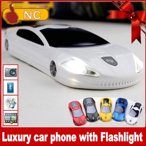 2014 New luxury mini car mobile phone F1 F1+ support Russian keyboard French unlocked dual SIM card flashlight cheap cell phones(China (Mainland))