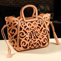 Women Handbags Hollow Out Totem Handbag Personality Inclined Shoulder Bag Fashion Cutout Carved Handbag Tassel Package