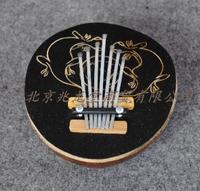 England World Rhythm. 7 Tones. Mbira. Thumb Piano. Finger Piano. African Indigenous Musical Instruments. Coconut Shell KALIMBA.