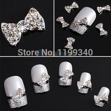 E9310pcs Wholesale 3D Clear Alloy Rhinestone Bow Tie Nail Art Slices DIY Decorations Free Shipping(China (Mainland))