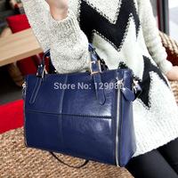 The new 2014 leather handbag patchwork handbag leather inclined shoulder bag bag free shipping