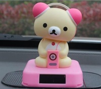 Toy bear solar shook his head doll bear to listen to music baby bear doll lovers car act the role ofing also like toys