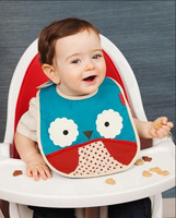 SKP waterproof adorable bib that fits into its own little pouch. baby tuck-away bibs