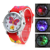 The new fashion Children's Butterfly Style Silicone Analog Quartz Wrist Watch with Flashing LED Light(quartz precision movement)