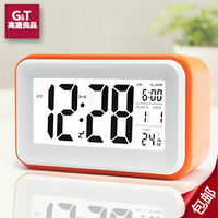 Creative  lazy small alarm clock  mute  luminous wise electronic clock bedside clock