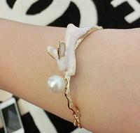 2014 New Fashion Korean Luxury Imitation Pearl Rabbit Bangle