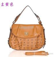 Free ship Clamshell-type women messenger bag leather handbags branddesigner  high quality bolsas mc clutch Totes m011